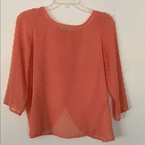 Soft coral colored sheer open back blouse